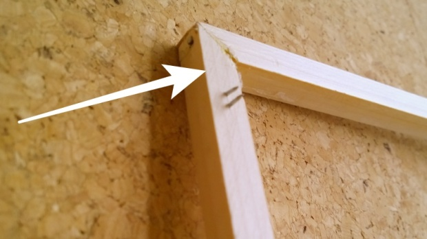 wooden frame with dangerous nails
